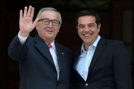 Jean-Claude Juncker, le président de la Commission européenne, etAlexis Tsipras, le premier ministre grec, àAthènes le 21 juin.