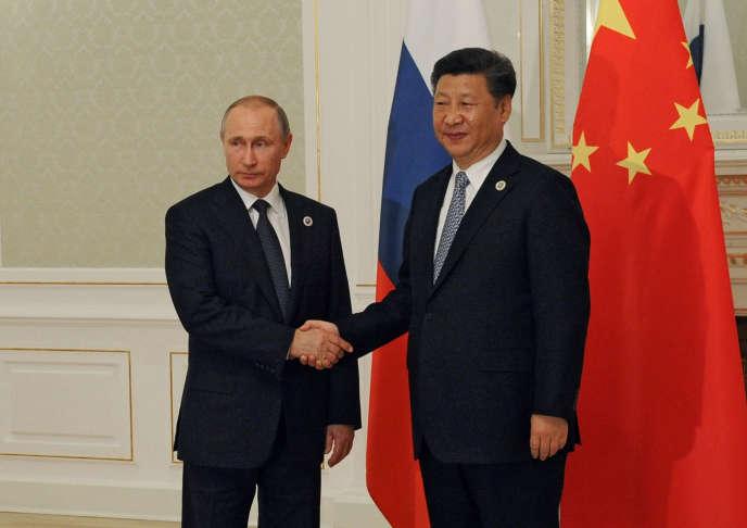 Le président russe Vladimir Poutine et son homologue chinois Xi Jinping jeudi 23 juin à Tachkent en marge du sommet de l'Organisation de coopération de Shanghaï.