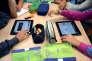 Des élèves utilisent des tablettes pendant leur cours, à Saint Brieuc, le 12 septembre.