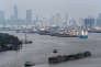 Cargo ships are pictured near the port in Bangkok, Thailand, March 25, 2016. REUTERS/Athit Perawongmetha