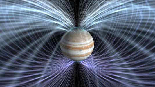 Vue d'artiste représentant les puissants champs magnétiques qui entourent Jupiter et les aurores ultraviolettes qu'ils engendrent aux pôles.