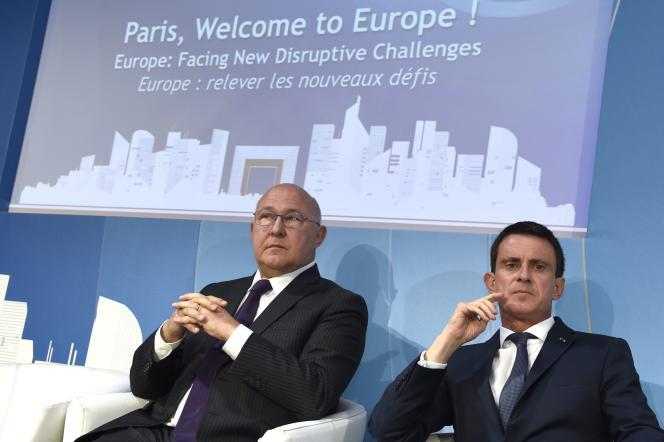 Manuel Valls (à droite) et Michel Sapin, le 6 juillet.