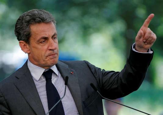 Nicolas Sarkozy a critiqué l'adoption tardive de cette mesure, longtemps étrillée par le Conseil d'Etat, mais qui figure bien désormais dans la loi.