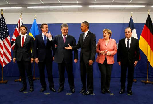 Matteo Renzi, David Cameron, Petro Porochenko, Barack Obama, Angela Merkel et Francois Hollande lors d'un sommet de l'OTAN à Varsovie, le 9 juillet.