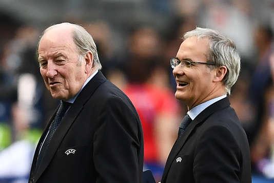 Jacques Lambert, le président de la société d'organisation de l'Euro 2016, etGiorgio Marchetti, le directeur des compétitions UEFA, au Stade de France, dimanche 10 juillet.