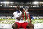 Football Soccer - Portugal v France - EURO 2016 - Final - Stade de France, Saint-Denis near Paris, France - 10/7/16 Portugal's Eder celebrates with the trophy after winning Euro 2016 REUTERS/Kai Pfaffenbach Livepic