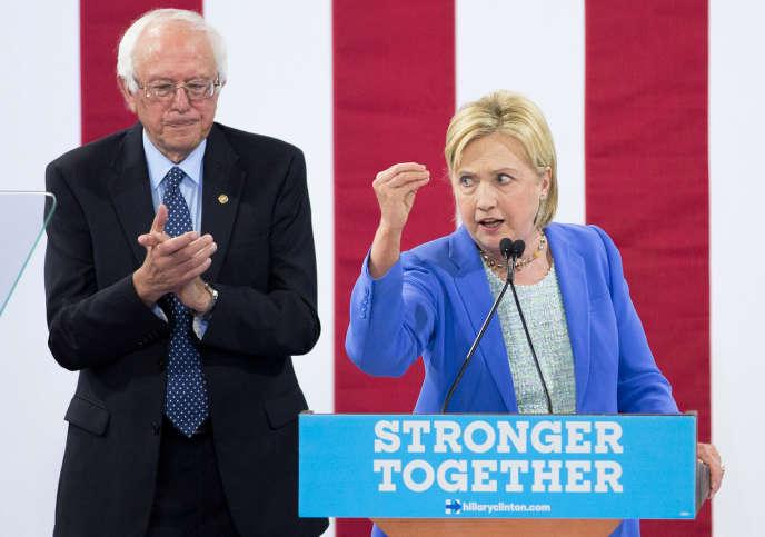 Après sa défaite à la primaire démocrate, Bernie Sanders s'est ralliésans états d'âme à Hillary Clinton. Ci-dessus, faisant front uni, le 12 juillet à Portsmouth (New Hampshire).