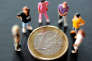 A picture taken on August 24, 2012 in Lille shows an illustration made with figurines and a euro coin. AFP PHOTO PHILIPPE HUGUEN / AFP PHOTO / PHILIPPE HUGUEN