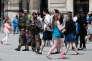 Devant le Musée du Louvre, à Paris, le 15 juillet.