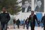 Des réfugiés syriens dans un camp à Islahiye, province de Gaziantep en Turquie, le 16 mars. En arrière plan les portraits de Mustafa Kemal Ataturk ( gauche) et Recep Tayyip Erdogan.