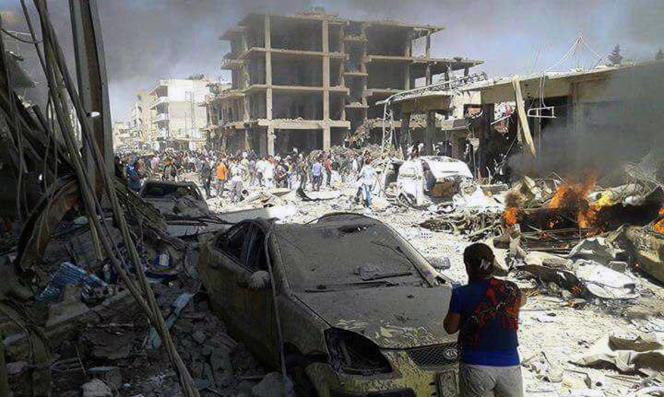 Après un attentat à la bombe à Kamechliyé, dans le nord-est de la Syrie, le mercredi 27 juillet (photo diffusée par l'agence de presse officielle syrienne SANA).