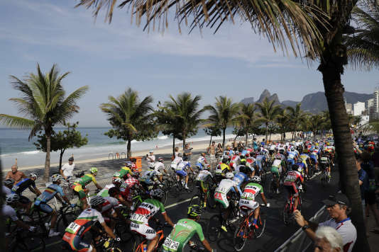 Cyclists ride on Ipanema beach during the men's cycling road race final at the 2016 Summer Olympics in Rio de Janeiro, Brazil, Saturday, Aug. 6, 2016. (AP Photo/Felipe Dana)