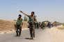 Des soldats afghans entrent dans le village de Nad-e-Ali, dans la province du Helmand, le 10 août 2016.