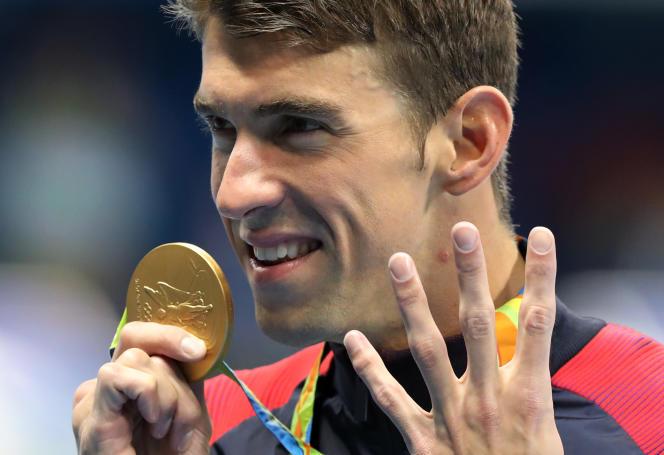 Deux mains ne suffisent plus pour compter toutes les médailles d'or deMichael Phelps.