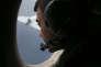 A bord d'un avion de l'armée de l'air autralienne, recherchant l'avion perdu de la Malaysian Airlines, le 22 mars 2014.
