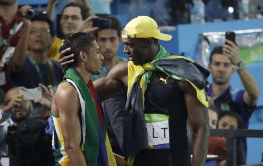 Wayde van Niekerk adoubé par le roi du sprint en personne, Usain Bolt.