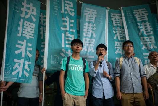 Joshua Wong, Nathan Law et Alex Chow lors d'une conférence de presse à Hongkong, le 15 août 2015.