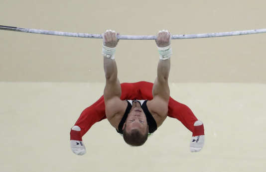 Germany's Fabian Hambuechen performs on the horizontal bar during the artistic gymnastics men's apparatus final at the 2016 Summer Olympics in Rio de Janeiro, Brazil, Tuesday, Aug. 16, 2016. (AP Photo/Julio Cortez)