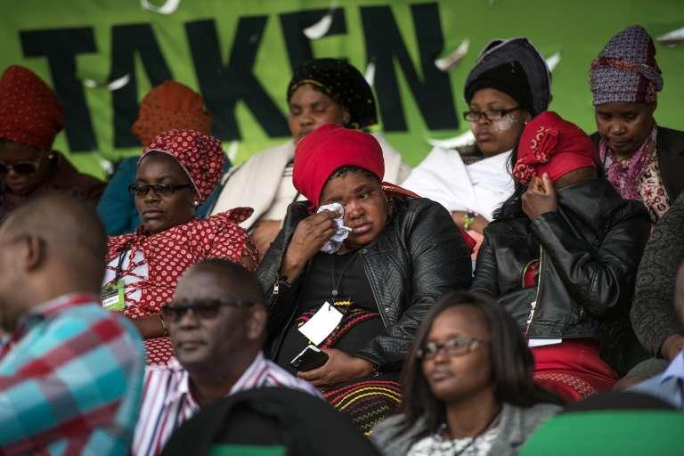 Des proches des mineurs tués ont assisté au rassemblement organisé pour le quatrième anniversaire du lors du massacre de Marikana,le 16 août 2016, à Rustenberg (Afrique du Sud).