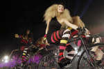 FILE - In this Dec.1, 2009 file photo, models wear creations by French fashion designer Sonia Rykiel as part of her show designed for H&M, in Paris. Rykiel, whose relaxed striped sweaters helped liberate women from their stuffy suits and who went on to run a global fashion empire, has died at 86, according to the French president's office. (AP Photo/Thibault Camus, File)