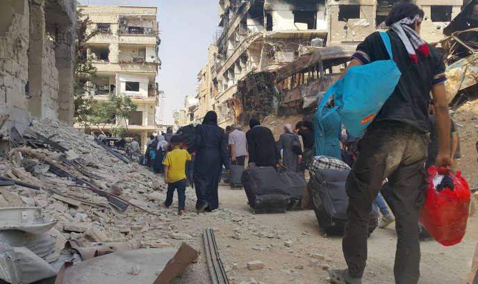 L'évacuation de Daraya, vendredi 26 août 2016.