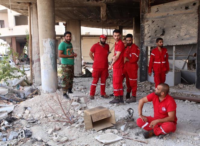 Les véhicules du Croissant-Rouge syrien sont entrés à Daraya vendredi 26 août.