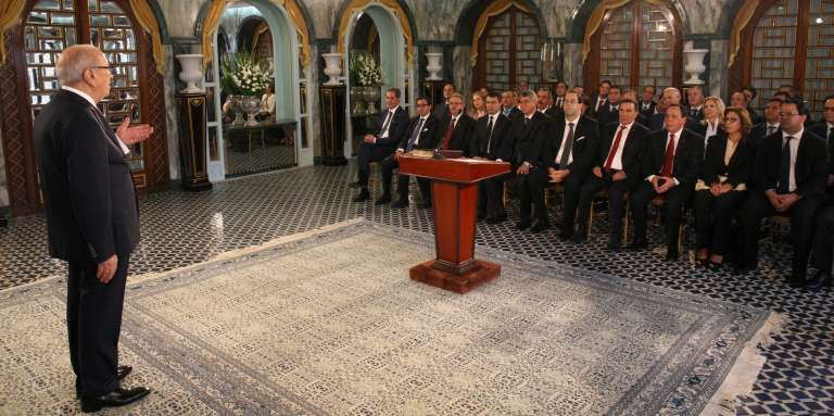 """A handout picture provided by the Tunisian Presidency Press Service on August 27, 2016, shows Tunisian President Beji Caid Essebsi (L) giving a speech in front of his new Prime Minister Youssef Chahed (C-5thL) and members of his cabinet during the country's new government swearing-in ceremony at Carthage Palace, near the capital Tunis. Tunisia's new Prime Minister Youssef Chahed and members of his cabinet were sworn in, the presidency said, after approval from parliament. The prime minister and his 26 ministers swore to """"work devotedly for the good of Tunisia"""" and to """"respect its constitution and laws"""", it said. - === RESTRICTED TO EDITORIAL USE - MANDATORY CREDIT """"AFP PHOTO / HO / TUNISIAN PRESIDENCY PRESS SERVICE """" - NO MARKETING NO ADVERTISING CAMPAIGNS - DISTRIBUTED AS A SERVICE TO CLIENTS === / AFP / TUNISIAN PRESIDENCY / TUNISIAN PRESIDENCY / HO / === RESTRICTED TO EDITORIAL USE - MANDATORY CREDIT """"AFP PHOTO / HO / TUNISIAN PRESIDENCY PRESS SERVICE """" - NO MARKETING NO ADVERTISING CAMPAIGNS - DISTRIBUTED AS A SERVICE TO CLIENTS ==="""