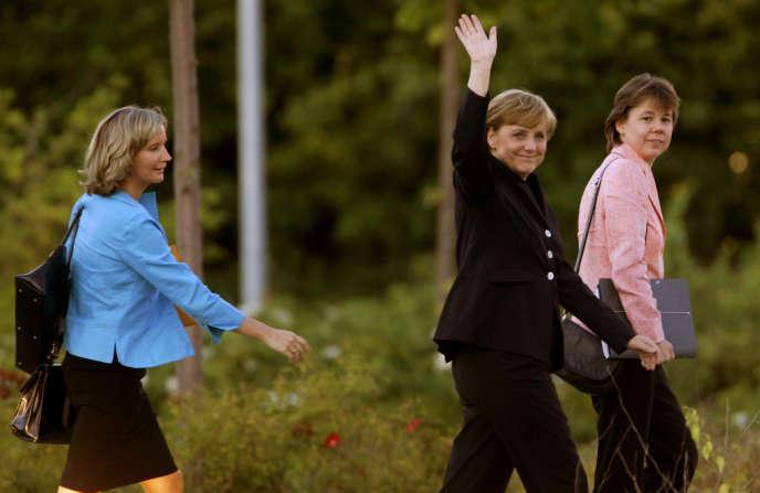 Eva Christiansen, Angela Merkel et Beate Baumann à Berlin, en septembre 2005.