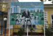A huge poster shows Uzbek President Islam Karimov posing with a group of children and the words reading 'Our children ought to be stronger and smarter than us and they ought to be happy!' is seen in front of an old building of a library in Tashkent, Uzbekistan, Monday, Aug. 29, 2016. Uzbekistan's authoritarian president, Islam Karimov, has suffered a brain hemorrhage, his daughter said Monday as security forces surrounded the hospital caring for him. (AP Photo)