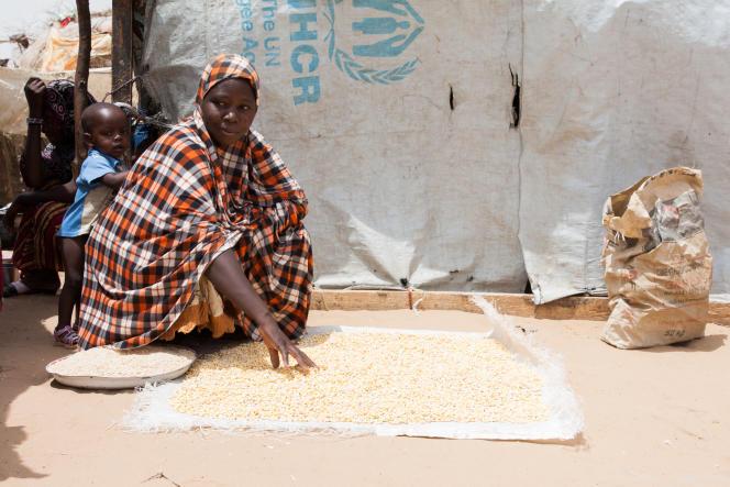 « Au camp, je m'occupe de mes enfants et concasse le maïs distribué par le Programme alimentaire mondial une fois par mois.»