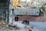 Un bus détruit dans le quartier Bab Al-Hadid d'Alep, le 14 septembre.