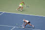 Sep 11, 2016; New York, NY, USA; Bethanie Mattek-Sands of the United States and Lucie Safarova of the Czech Republic return a shot to Caroline Garcia and Kristina Mladenovic of France in the championship match on day fourteen of the 2016 U.S. Open tennis tournament at USTA Billie Jean King National Tennis Center. Mandatory Credit: Anthony Gruppuso-USA TODAY Sports
