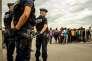 Migrants n'ayant pas pu rejoindre un centre d'accueil et d'orientation, à Calais, le 13 septembre.