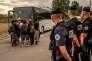 Départ de migrants vers un centre d'accueil et d'orientation, à Calais (Pas-de-Calais), le 13 septembre.