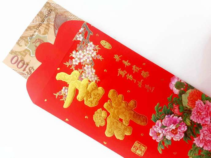 Les «hongbao», les traditionnelles enveloppes rouges de fête pleines de billets, sont au centre d'une guerre féroce que se livrent, en Chine, les services Alipay et WeChat,qui se sont imposés dans la vie des Chinois depuis les années 2010..