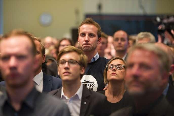 Des militants de la CDU, à l'annonce des résultats à Berlin, le 18 septembre.