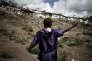 MAYOTTE - Kaweni, le 25 septembre 2008 - Un sans-papiers Comorien montre le bidonville de Kaweni, habite essentiellement par des personnes dans la meme situation que lui.