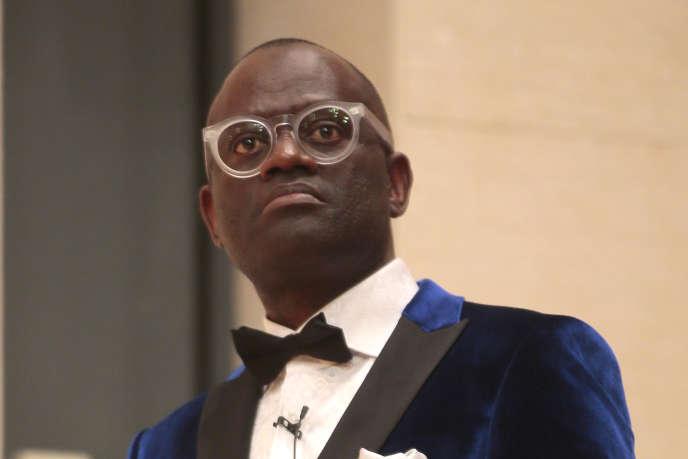 L'auteur franco-congolais Alain Mabanckou à l'inauguration de la session de leçons qu'il a données au Collège de France en mai 2016.
