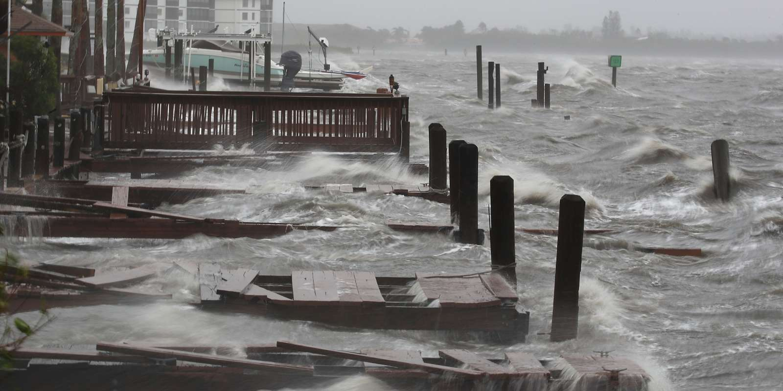 COCOA BEACH, FL - OCTOBER 07: Heavy waves caused by Hurricane Matthew pound the boat docks at the Sunset Bar and Grill, October 7, 2016 on Cocoa Beach, Florida. Hurricane Matthew passed by offshore as a catagory 3 hurricane bringing heavy winds and minor flooding. Mark Wilson/Getty Images/AFP == FOR NEWSPAPERS, INTERNET, TELCOS & TELEVISION USE ONLY ==