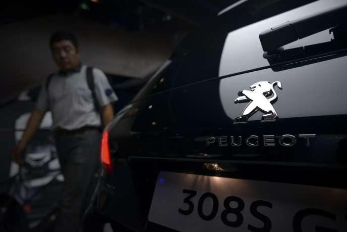 Dans les usines Peugeot à Pékin en mai.