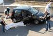 Des policiers et experts légistes travaillent sur la scène du crime près du cadavre d'Adrien Anigo,le 5 septembre 2013,à Marseille.