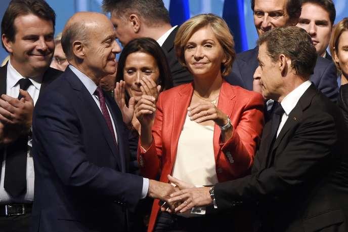 Alain Juppé, Valérie Pécresse et Nicolas Sarkozy lors d'un meeting pendant la campagne des élections régionales, le 27 septembre 2015.