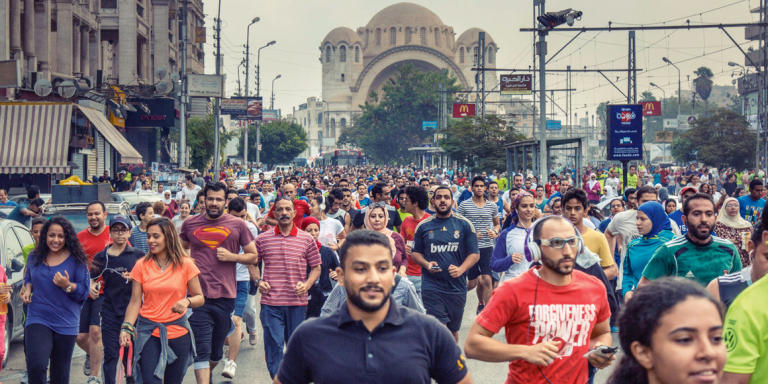 Hundreds of people participate in a 5km run organized by a community group called Cairo Runners in the Heliopolis neighborhood of Cairo, Egypt on October 14, 2016