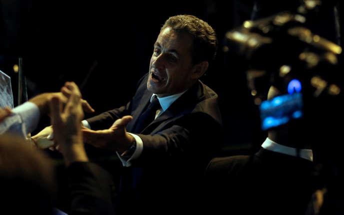 Nicolas Sarkozy arrivant à un meeting, àMarseille, le 27 octobre.