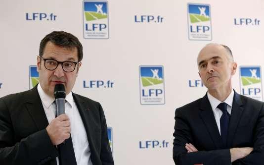 Le directeur général exécutif de la Ligue de football professionnel, Didier Quillot (à gauche), et Jean-Pierre Denis, président « intérimaire» de la LFP, le27mai2016.