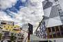«Cinq impôts pèsent sur le foncier et l'immobilier. Les contribuables constatent au sein d'une même ville des écarts allant du simple au double dans le montant de la taxe foncière pour un bien de même valeur» (Photo: immeubles en construction, grues de chantier. Projet Presqu'ile Grenoble Innovation for Advanced New Technologies»).