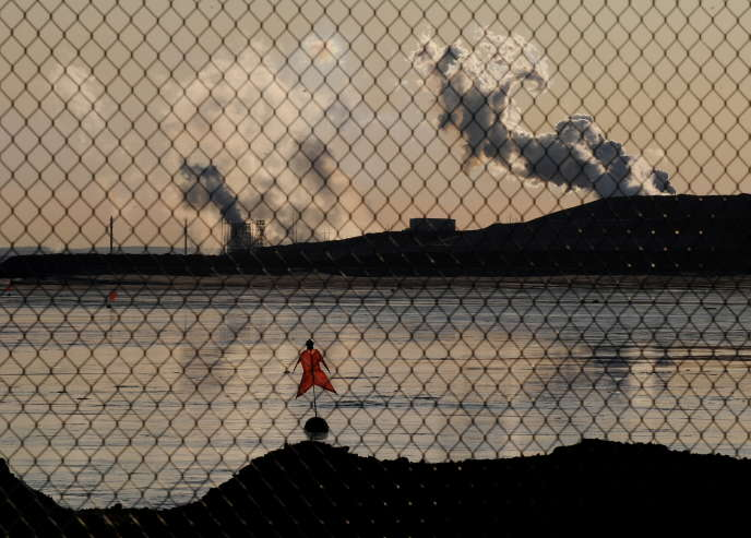 A scarecrow lies in a tailings pond in front of the Suncor oil sands extraction facility near the town of Fort McMurray in Alberta Province, Canada on October 25, 2009.