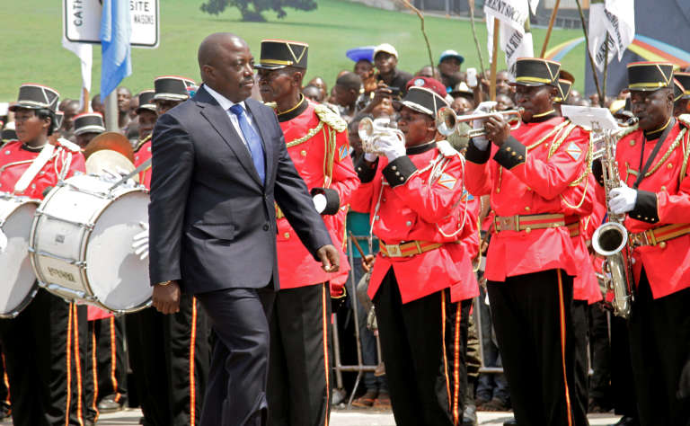 Democratic Republic of the Congo's President Joseph Kabila inspecting a guard of honour during the celebrations of Congo's independence in Kindu, June 30, 2016. He has been wiretaped by the British intelligence service