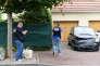 Des policiers au domicile d'Adel Kermiche, à Saint-Etienne-du-Rouvray (Seine-Maritime), le 27 juillet.