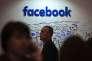 """«Lorsqu'il a cofondé Facebook, Mark Zuckerberg ne pensait probablement pas qu'il développait une infrastructure qui deviendrait un des outils de coordination du """"printemps arabe""""». (Photo : le stand Facebook au Web Summit de Lisbonne, le Salon technologique de référence en Europe, le 9 novembre)."""